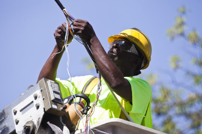 Communications Laborer working in Ohio installing Line