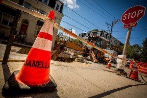 Philadelphia Gas Works Project Street Work - excavating street/dirt, Danella orange safety cone forefront