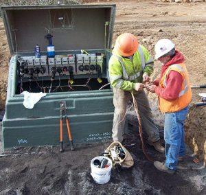 Men installing electric infrastructure
