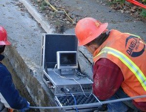 Man with diagnostic equipment on electric installation jobsite