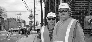 Two construction managers on job site