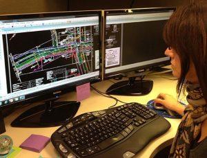 Closeup of design engineer working at computer workstation