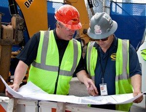 Two Danella Employees Surveying Utility Construction Maps