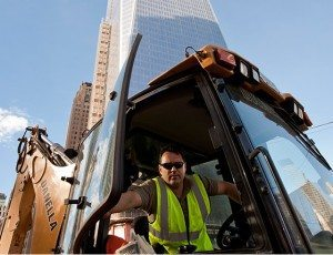 Danella Core Value - Excellence - Backhoe Operator outside of newly construction Word Trade Center Memorial