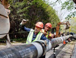 Men installing large gas lines