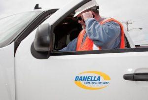 Man talking on cell phone on gas installation jobsite