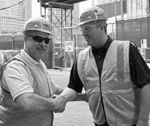 Danella Core Value - Respect (Black and White Image) - Two Employees Shaking Hands