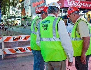 Men discussing how to safely execute job function