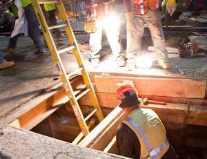 men working in hole