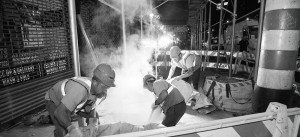 Men on site working on steam pipe installation