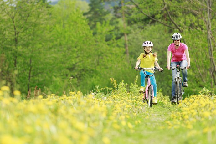 Biking - Bike riding - young girl with mother on bike, active family concept