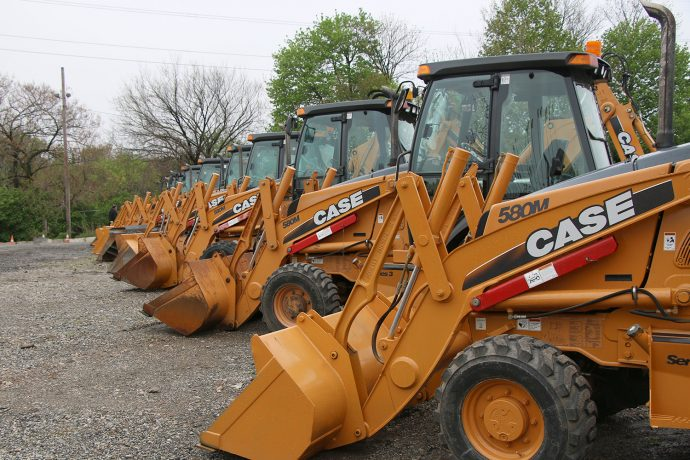 Danella 30th Annual Auction - Line up of backhoes
